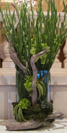 This would be a fabulous event arrangement even without the branches. The flowers are only slightly open and look great that way.....