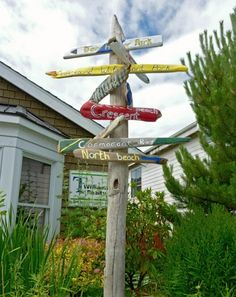 what a cool use for driftwood ... will have to go collecting on the beach when it warms up ... maybe by mid july???   Beachcomber Garden Paradise -Beach Landscaping Ideas with Shore Finds