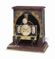A FRENCH GILT AND PATINATED BRONZE 'INDUSTRIAL' NOVELTY COMPENDIUM CLOCK 'LOCOMOTIVE AND TUNNEL'