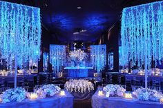 Icicle-inspired centerpieces and frosty uplighting create a dazzling winter wonderland.Photo Credit: John Labbe/Created by: Preston Bailey