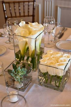 Simple and beautiful: White roses cut short and lined up in short square glass container, taller square with taller white callas and some kind of succulent in smallest square vase - modern diy decor ideas #Flowerarrangements