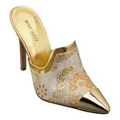 "As seen in Elle Accessories.....Pointy toe slide pump with 4 1/4"" heel."