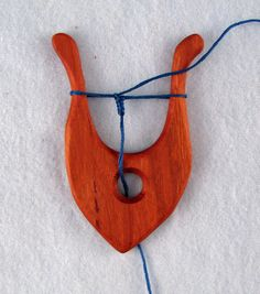 This is Lucet fork.  It is an ancient tool used to make cord. It has been used for centuries since the Vikings to turn fiber thread into cord. Making lucet cording is easy to learn and goes very fast.  I have made lucet cord out of any and everything that can be considered cordage.  There are several YouTube videos on how to make lucet cording.