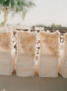 Wedding chair covers. So pretty!