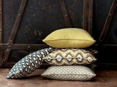 Pillows in the Nate Berkus fabric El Toro/Aegean, in the Nate Berkus fabric Ahmar/Citrine, in the Nate Berkus fabric San Rafael/Citron, and in the Nate Berkus fabric Desi/Dover.