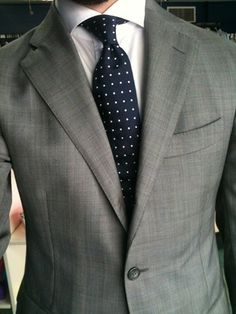 Lite grey suit with a dark blue tie with dots. Just a beautiful ensemble. You can't go wrong with this!!