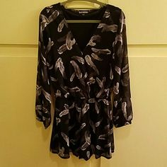 Express romper Black Express romper with gray feather pattern. Lining inside and sheer only on the sleeves. Only worn once! Express Dresses