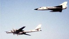 F-106 Delta Dart escorting a Russian Tu-95 Bear bomber.