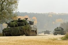 German Army Leopard II tanks, assigned to 104th Panzer Battalion, move through the Joint Multinational Readiness Center during Saber Junction 2012 in Hohenfels, Germany, Oct. 25. The U.S. Army Europe's exercise Saber Junction trains U.S. personnel and 1800 multinational partners from 18 nations ensuring multinational interoperability and an agile, ready coalition force.  (U.S. Army Europe)