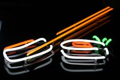 Sushi neon sing with letters and logotype neon illumination marquee sign fluorescent tubes