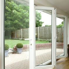 Bi-Fold Door in white, opening out this living space Sources Of Calcium, Creative Kids Snacks, Healthy Filling Snacks, Aluminium Doors, No Dairy Recipes, Afternoon Snacks, Solar Lights, Decorating On A Budget, Living Spaces