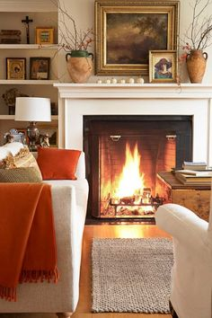 A roaring fire takes center stage in the living room of this New Hampshire home.