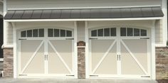 Two 9x8 Model 5333 carriage house overlay garage doors with Arched Madison top glass & spade hardware installed by the Richmond store. #teamappledoor