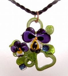 This is too freakin' cool....lampworked and fused.  Fantastic!