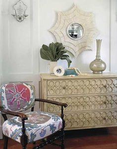 bone sunburst mirror, antique tashkent upholstered chair, and murano dresser.  Betsy Burnham.