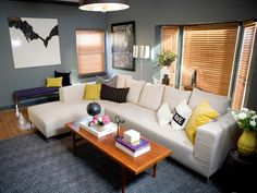 Wooden+blinds+flood+this+contemporary+living+room+with+a+film+noir+look.+