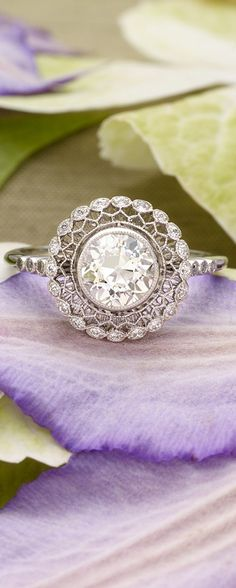 Love the antique feel of this gorgeous diamond engagement ring.