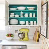 Via A Beautiful Mess: Even if your dishes are stored behind doors, give them a little glam treatment by painting the inside cabinets.