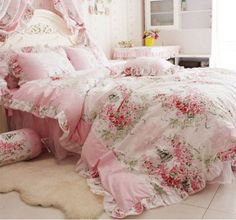 vintage inspired pink bedding with pink flowers and greenery for a princess room