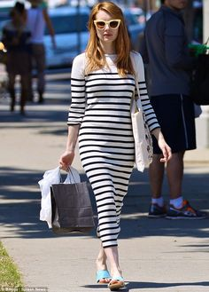 Figure-flaunting fashion :Slipping into an understated yet highly chic knitted maxi dress, the 25-year-old actress flaunted her incredible figure as she sashayed down Melrose Avenue