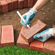 Use a masonry pencil, and a straightedge if necessary, to draw lines connecting the marks at each end of the brick to form your cutlines.