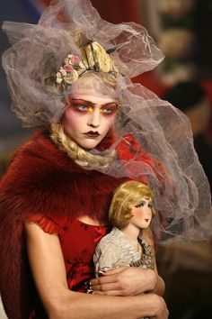 Dior. Pinning this for the rich reds and because I'm intrigued by the doll and what it does to the whole image