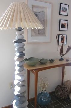 Stone lamp made from beach rocks. Tutorial at Completely Coastal  how to drill holes in the rocks