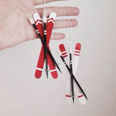 """Cute skis to DIY! Would be even cute to """"un-ornament"""" them and just have them be a winter decoration!"""