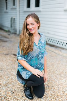 This relaxed tunic tee with mandarin collar and 3/4 length sleeves is perfect for fall. The high-low hem paired with leggings or jeans is perfect for that classic fall look. Details: - Versatile style