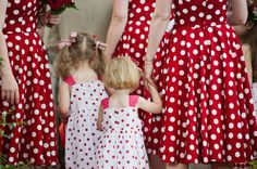 red and white polka dot bridesmaids with reverse colour flower girls
