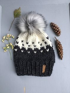 "Chunky knit hat with Faux fur Pom Pom -The Boone"" hat -Cozy, soft and warm -Gorgeous Faux fur Pom Pom -Colors - Charcoal and Fisherman -Fair isle design -100% Handmade by me -Ready to ship The Boone"" hat is such a cute and comfy hat. It is inspired by my favorite mountain town of"