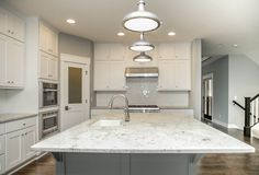 This LDK custom kitchen is one-of-a-kind! Sparkling white, bright, and cool feel, you will want this in your new home!