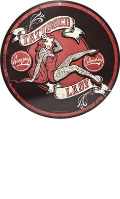 """RETRO TATTOOED LADY TIN SIGN    Step right up and see Retro A Go Go's fabulous tattooed lady on this amazing metal sign! This aged, metal sign features a tattooed pinup in the center with """"Tattooed Lady"""" & """"Amazing...Shocking"""" in banners & circles. There is a punched hole at the top for easy hanging.      $25.00"""
