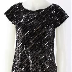 Alice & Olivia sequin top size Xs black silver MAKE AN OFFER!!!! Women's ALICE + OLIVIA Black And Silver Sequin Short Sleeve Sheer Blouse Size XS  Features:  Collar: N/A Sleeve Style: Short Sleeve Neckline: Round Print: Sequin Embellishment: N/A Pockets: N/A Lining: Lined Closure: N/A Size: XS Color: Black Fabric: 100% Silk Alice + Olivia Tops Blouses