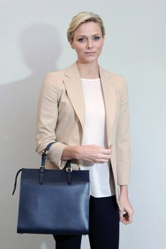 Charlene Wittstock accessorizing with a Giorgio #Armani handbag.