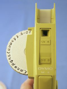 the M-6 Dymo label machine with cursive- I used to have one of these. I labeled EVERYTHING when I was a kid.