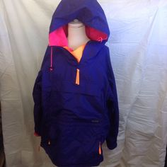 Columbia pull over beautiful vibrant colors New condition vibrant colors hot pink orange. Zip up sides and 2 storage pockets up front tags says men's Large so it would fit a women's large since Columbia runs small Columbia Jackets & Coats