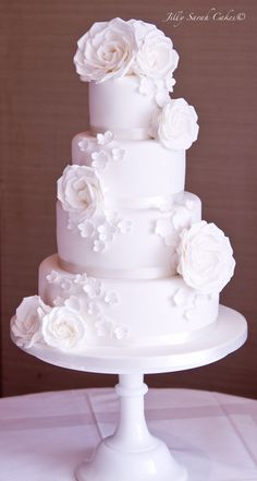 All white Wedding cake...flowers need to be red