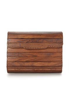 French Connection wooden envelope-clutch bag is a quirky, unique style. Wear with a simple silk vest or shift dress and let the bag be the centre of attention. <P>Panel Wooden Bag has thin chain shoulder-strap, fold-over flap with magnetic fastening and an interior fabric pocket.</P>