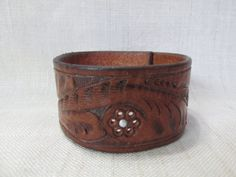 Hey, I found this really awesome Etsy listing at https://www.etsy.com/listing/221501604/leather-cuff-repurposed-upcycled-belt