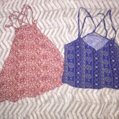 2 Hollister tank tops! BUNDLE Both adorable summer tops, the red one has a cute trouble pattern, red and white size extra small! The blue one is a small because it is a crop top, it's blue and has a cute pattern to go along with it. This is a bundle! Hollister Tops Tank Tops