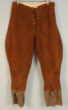 MAN'S SUEDE JODPHURS, 1930's. Cognac with six button fly front and leg with four horn buttons, the lower leg of olive twill with five smaller buttons, interior waistband pocket and belt loops, button plackets lined with buckram. Waist 31, hip 48, length 38. $115.00