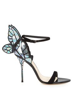 For an ultra-feminine finish to your look, try Sophia Webster's black Chiara sandals. They have a minimal strappy silhouette, but stay true to the label's pretty predilections with a 3-D black and iridescent butterfly wing at the heel. Show them off fully with cropped trousers.