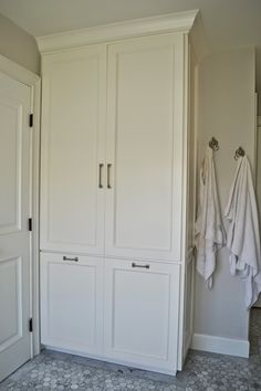 install tall cabinet instead of built out closet for linen storage; in master bath; The Cape Cod Ranch Renovation