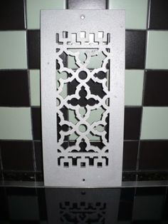 White scroll metal grille