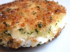 Pan-fried goat cheese. Basic breading and herbs, fried in olive oil. Goat cheese is HEAVENLY when warm - comforting, filly, super creamy. by jd1