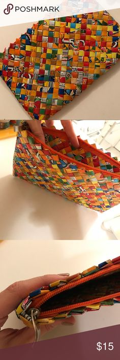 One of a kind candy wrapper clutch From a local artisan in Cape Cod, this vibrant clutch with an exterior made from candy wrapper materials is a great find. Bags Clutches & Wristlets