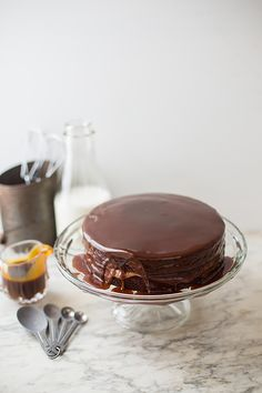 <p>This mouthwatering Salted Caramel Drenched Coffee-Double Chocolate Cake looks so divine that it may actually inspire me to put my baking gloves on. Two layer cake with chocolate frosting sandwiched
