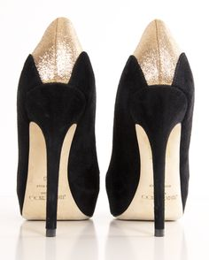 Jimmy Choo black and glittered gold./