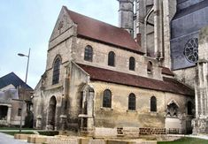 """Beauvais: The Basse Œuvre (French for """"Lower Work"""", as distinct from the Nouvel-Œuvre (= """"New Work"""", the present cathedral)), in full the Parish Church of Our Lady of the Basse Œuvre of Beauvais is a church at the west end of Beauvais Cathedral, dated to the 10th century."""
